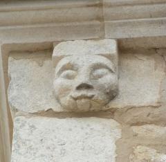 Chapelle du cimetière dite Chapelle Sainte-Libaire - English: Sculpted head on a corbel at the left of the entrance side, Saint-Libaire chapel, Grand, Vosges, France.