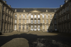 Ancienne abbaye de Saint-Waast - This building is classé au titre des Monuments Historiques. It is indexed in the Base Mérimée, a database of architectural heritage maintained by the French Ministry of Culture,under the reference PA00107962 .