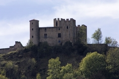 Tour - English:  The Castle of Essalois, seen from the dam of Grangent.
