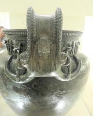 Site et tombe princière de Vix -  A handle of the Vix krater, featuring the face of the Gorgon Medusa, on display at the Musée du Pays Châtillonnais in Châtillon-sur-Seine, France