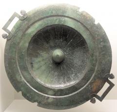 Site et tombe princière de Vix -  The lid of the Vix krater, on display at the Musée du Pays Châtillonnais in Châtillon-sur-Seine, France