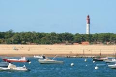 Phare - Français:   Le phare du Cap-Ferret vu depuis les flots du bassin d'Arcachon.