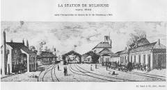 Immeubles entourant le square de la Bourse - Français:   Gare de Mulhouse sur le chemin de fer Strasbourg-Bâle