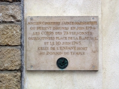 Eglise Sainte-Marguerite -  Commemorative plaque on Église Sainte-Marguerite, rue Saint-Bernard (Paris XIe arrondissement), mentioning that in the cemetery behind (now closed), were interred 73 people guillotined during the French Revolution, as well as the young boy who died in June 1795 at the