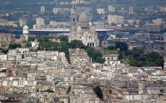 Eglise Saint-Pierre-de-Montmartre - English: Sacré-Cœur church and stade de France behind