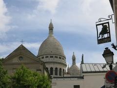 Eglise Saint-Pierre-de-Montmartre -  Saint Pierre de Montmartre and the dome of Basilique du Sacré-Cœur de Montmartre, Paris, France.