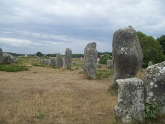 Six menhirs de l'enceinte du Ménec - This building is indexed in the Base Mérimée, a database of architectural heritage maintained by the French Ministry of Culture,under the reference PA00091074 .