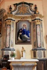 Eglise Saint-Cyr - Français:   Église Saint-Cyr (Moréac), retable sud, avec une vierge à l\'enfant et un moine