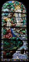 Eglise Notre-Dame - English: Stained glass window from Bonneval Church showing the Vision of Saint Bernadette of Lourdes
