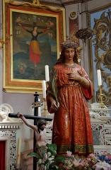 Eglise Sainte-Julie - Русский:   Статуя и картина с изображением мученичества святой Иулии Корсиканской в посвящённой ей католической церкви города Нонца.