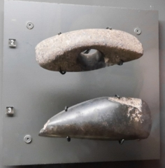 Groupe de six tumuli - English: Neolithic axes: 2: naviform ax with transverse perforation, 3: polished ax with sawing marks on the side. The sawing of the stone was obtained by the continuous friction of a link to which was added water and an abrasive material. Musée des tumulus de Bougon.