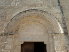 Eglise Saint-Jean-Baptiste - English: Church of Saint-Jean-Baptiste in Castelnau-le-Lez (vicinity of Montpellier, France). South side. Main portal. Tympanum.