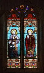 Eglise Saint-Vivien -  Stained glass window, remembrance of mission 1892 (a change from the crosses...): Saint Vincent and Saint Vivien by G.P. Dagrand whose identity is shown in a cartouche at the bottom of the stained-glass window and by a monogram with the date 1893 on the stained-glass window itself (at the end of St Vincent's shoe).
