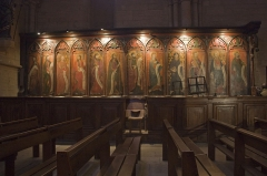 Eglise Saint-Philibert - English:  Carved stalls painted by Master Collinet, representing the twelve apostles holding verses of the Credo (and a word of Saint Paul) in a phylactery.