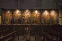 Eglise Saint-Philibert - English:  Carved stalls painted by Master Collinet, representing twelve saints.