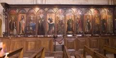 Eglise Saint-Philibert - English:  Carved stalls painted representing saints.