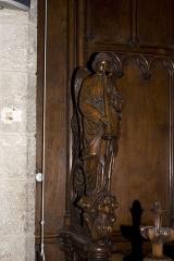 Eglise Notre-Dame - English:  Cheek choir stalls: angel blewing in the trumpet of Judgement.