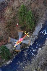 Pont suspendu de la Caille (également sur commune de Cruseilles) - English:  Eurocopter EC 145 of the french Sécurité Civile under the bridge Pont de la Caille over the river Les Usses; Haute-Savoie, France.