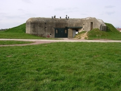 Batterie d'artillerie de Merville -  The Merville Gun Battery was a coastal fortification in Normandy, France, in use as part of the Nazis' Atlantic Wall built to defend continental Europe from Allied invasion. It was a particularly heavily fortified position and one of the first places to be attacked by Allied forces during the Normandy Landings commonly known as D-Day.   http://www.1940.co.uk/history/article/merville/merville.htm
