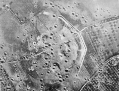 Batterie d'artillerie de Merville - English: IWM caption: PHOTOGRAPHIC INTELLIGENCE FOR OPERATION 'OVERLORD'. Overhead aerial of the gun battery at Merville (3km east of Ouistreham) consisting of four medium casemates, after air bombardment, c May 1944. Bombing failed to penetrate the casemates and, because of the threat the battery posed to the landings on SWORD Area, it was attacked and neutralised by 9th Bn the Parachute Regiment in the early hours of 6 June.