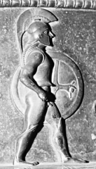 Site et tombe princière de Vix - English: Hoplite, detail of the Vix Krater. Hammered bronze sheet, Laconian influence, ca. 510 BC. From the Vix hoard, now in Châtillon-sur-Seine.