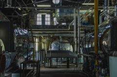 Bains municipaux -  Pour chauffer cet immense bâtiment (ainsi qu'une partie du quartier), une grande salle remplie de tuyaux, réservoirs, machines et j'en passe réussirent pendant plus de 100 ans à réussir leur objectif...