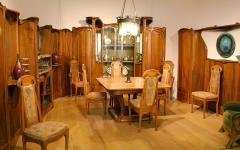 Ancien hôtel particulier d'Hector Guimard - English:   This is the dining room designed by the architect Hector Guimard for his house, L\'hôtel Guimard. He designed almost everything in the room, from the chairs to the glass cabinets in the back. The wood is mostly pear wood. The room\'s cohesive design is a fine example of Art Nouveau. The room is preserved in the Petit Palais.