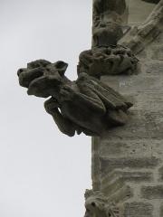 Eglise Saint-Ouen - Extérieur de l'église Saint-Ouen des Iffs (35). Clocher. Détail sculpté.