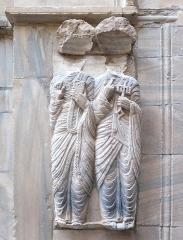 Ancien grand Séminaire - English: Medieval marble sculpture of two saints (faces destroyed) at the portal of Église Saint-Jean le Vieux de Perpignan, situated in the small court NW of Perpignan Cathedral   Ministère de la Culture (France): Base Mémoire:  MHR91_20086604953