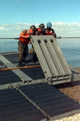 Cimetière américain et la chapelle de Meuse-Argonne - English: Sailors from Beachmaster Unit 2 flip over one of the ramps of a lighter craft in preparation for unloading equipment brought ashore near Paldiski, Estonia, from the S.S. Sgt. Matej Kocak during Exercise Baltic Challenge 97, on July 14, 1997. Baltic Challenge '97 is a multinational exercise conducted as a NATO Partnership for Peace initiative involving more than 2,600 military personnel from Denmark, Estonia, Finland, Latvia, Lithuania, Norway, Sweden, and the U.S. The focus of the training is peacekeeping tasks and humanitarian assistance operations. The lighter craft are being used to move equipment off-loaded from the Maritime Prepositioning Ships anchored off shore to the exercise area on the beach. Beachmaster Unit 2 is homeported in Little Creek, Va.