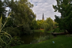 Jardin botanique - English:  View from the Botanical Garden to the church tower of the Église Saint-Maurice de Strasbourg.
