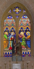 Eglise -  The Visitation, stained glass by Louis Bordieu, painter and  glass-maker from Toulouse. First lancet; Joseph and Mary; second lancet; Elizabeth and Zechariah.