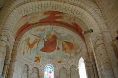 Eglise Saint-Etienne - Paulnay (Indre)  Eglise Saint-Etienne.  (Fresque du cul-de-four)  Construite dans le plus pur style roman poitevin, l'église actuelle ne remonte pas au-delà du XIIe siècle.  La façade, qui ressemble à celle de Notre-Dame de Fontgombault (Indre), est remarquable par son magnifique portail orné de sculptures (motifs végétaux, sirènes, oiseaux)  Paulnay possède un bel ensemble de fresques (15ème siècle): vestiges de l'Enfer (côté nord de la nef), calendrier et travaux des mois, anges musiciens (travée droite du chœur), Christ en majesté au cul-de-four, et au-dessous sous forme de bandeau les épisodes du martyre de saint Etienne, patron de l'église.  Le site de Paulnay remonterait à une époque antérieure au Moyen-Age, en effet lors de fouilles, les assises d'un temple gallo-romain ont été découvertes ainsi que des inhumations dont les plus anciennes dateraient de l'époque mérovingienne comme le témoignent les deux sarcophages exposés sur le parvis.  Le bourg de Paulnay a révélé plusieurs milliers de sépultures sur la place devant l'église.    St. Stephen's Church.  Built in typical Roman-style Poitevin, the current 12th century church.  The facade, similar to that of Our Lady of Fontgombault (Indre), is remarkable for its beautiful portal decorated with sculptures (plant motifs, sirens, birds)  Paulnay has a fine collection of paintings (15th century): remains of Hell (north side of the nave), calendar and work for months angel musicians (right row of the choir), Christ in Majesty on the cul-de-four , and below in the form of banner episodes of the martyrdom of St. Stephen, the church's patron.  Site Paulnay dates back to a time before the Middle Ages. Indeed, during excavations, the foundations of a Roman temple were discovered. The two sarcophagi, exposed on the square are of Merovingian.  The village of Paulnay revealed several thousand graves in the square outside the church.
