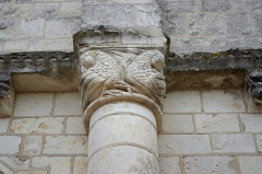 Eglise Saint-Etienne - Paulnay (Indre)  Eglise Saint-Etienne.  (Détail du la façade).  Construite dans le plus pur style roman poitevin, l'église actuelle ne remonte pas au-delà du XIIe siècle.  La façade, qui ressemble à celle de Notre-Dame de Fontgombault (Indre), est remarquable par son magnifique portail orné de sculptures (motifs végétaux, sirènes, oiseaux)  Paulnay possède un bel ensemble de fresques (15ème siècle): vestiges de l'Enfer (côté nord de la nef), calendrier et travaux des mois, anges musiciens (travée droite du chœur), Christ en majesté au cul-de-four, et au-dessous sous forme de bandeau les épisodes du martyre de saint Etienne, patron de l'église.  Le site de Paulnay remonterait à une époque antérieure au Moyen-Age, en effet lors de fouilles, les assises d'un temple gallo-romain ont été découvertes ainsi que des inhumations dont les plus anciennes dateraient de l'époque mérovingienne comme le témoignent les deux sarcophages exposés sur le parvis.  Le bourg de Paulnay a révélé plusieurs milliers de sépultures sur la place devant l'église.    St. Stephen's Church.  Built in typical Roman-style Poitevin, the current 12th century church.  The facade, similar to that of Our Lady of Fontgombault (Indre), is remarkable for its beautiful portal decorated with sculptures (plant motifs, sirens, birds)  Paulnay has a fine collection of paintings (15th century): remains of Hell (north side of the nave), calendar and work for months angel musicians (right row of the choir), Christ in Majesty on the cul-de-four , and below in the form of banner episodes of the martyrdom of St. Stephen, the church's patron.  Site Paulnay dates back to a time before the Middle Ages. Indeed, during excavations, the foundations of a Roman temple were discovered. The two sarcophagi, exposed on the square are of Merovingian.  The village of Paulnay revealed several thousand graves in the square outside the church.