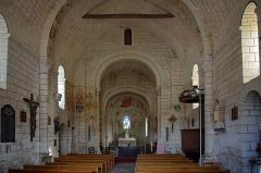Eglise Saint-Etienne - Paulnay (Indre)  Eglise Saint-Etienne.  (La nef)  Construite dans le plus pur style roman poitevin, l'église actuelle ne remonte pas au-delà du XIIe siècle.  La façade, qui ressemble à celle de Notre-Dame de Fontgombault (Indre), est remarquable par son magnifique portail orné de sculptures (motifs végétaux, sirènes, oiseaux)  Paulnay possède un bel ensemble de fresques (15ème siècle): vestiges de l'Enfer (côté nord de la nef), calendrier et travaux des mois, anges musiciens (travée droite du chœur), Christ en majesté au cul-de-four, et au-dessous sous forme de bandeau les épisodes du martyre de saint Etienne, patron de l'église.  Le site de Paulnay remonterait à une époque antérieure au Moyen-Age, en effet lors de fouilles, les assises d'un temple gallo-romain ont été découvertes ainsi que des inhumations dont les plus anciennes dateraient de l'époque mérovingienne comme le témoignent les deux sarcophages exposés sur le parvis.  Le bourg de Paulnay a révélé plusieurs milliers de sépultures sur la place devant l'église.    St. Stephen's Church.  Built in typical Roman-style Poitevin, the current 12th century church.  The facade, similar to that of Our Lady of Fontgombault (Indre), is remarkable for its beautiful portal decorated with sculptures (plant motifs, sirens, birds)  Paulnay has a fine collection of paintings (15th century): remains of Hell (north side of the nave), calendar and work for months angel musicians (right row of the choir), Christ in Majesty on the cul-de-four , and below in the form of banner episodes of the martyrdom of St. Stephen, the church's patron.  Site Paulnay dates back to a time before the Middle Ages. Indeed, during excavations, the foundations of a Roman temple were discovered. The two sarcophagi, exposed on the square are of Merovingian.  The village of Paulnay revealed several thousand graves in the square outside the church.