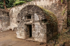 Cachot de Siparis - English:  The cell is notable for being a separate building, probably in the cellarof the main prison. Note there are technically no windows, but it appears the original door covered both openings.