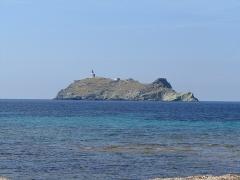 Phare de la Giraglia, sur l'île de la Giraglia -  A rocky island with a lighthouse on it near Cap Corse, Corsica, France.