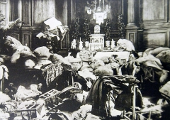 """Eglise de la Nativité de la Vierge -  Lot-10282-23:  WWI French Activities.  Original caption, """"Sermaize Church containing the property of 300 refugees and sacked by the Germans during their retreat in 1917.""""   Halftone image photographed from the book, Guerre, 1914-1919.   Courtesy of the Library of Congress.  (2016/09/30)."""