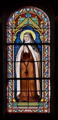 Eglise Saint-Junien de Vaussais - Français:   Vitrail (probablement Thérèse de Lisieux) par Julien Fournier, 1884; église de Sauzé-Vaussais, Deux-Sèvres, France.