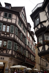 Maison - English:   France. Grand Est, Haut-Rhin. Colmar. . A street view. House façades in timberwork. . Cultural heritage; Cultural heritage|Monuments; Cultural heritage|Monuments|Private house; Europe|France; Europe|France|Grand Est; Europe|France|Grand Est|Haut-Rhin; Europe|France|Grand Est|Haut-Rhin|Colmar. Ref: PM_049873_F_Colmar. Photo: Paul M.R. Maeyaert. www.polmayer.com. © Paul M.R. Maeyaert; pmrmaeyaert@gmail.com. DO NOT CHANGE THE FILE NAME. NE PAS CHANGER LE NOM DE FICHIER.