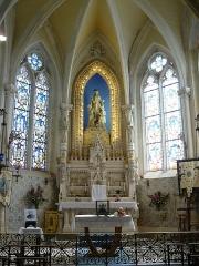 Basilique Notre-Dame-des-Enfants - Français:   Chapelle de Notre-Dame des Enfants avec ses bannières de pèlerinage
