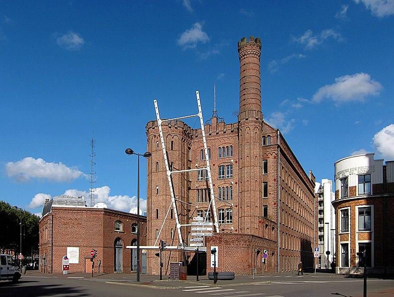 Photo du Monument Historique Usine Motte-Bossut, actuellement centre des archives du monde du travail situé à Roubaix