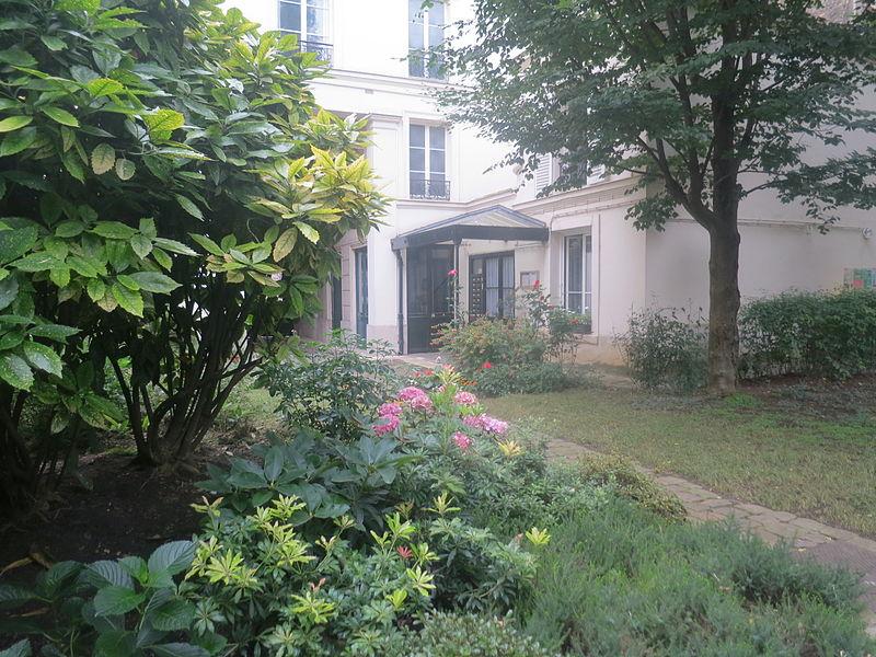 Photo du Monument Historique Hôtel, au fond du jardin situé à Paris 5e Arrondissement