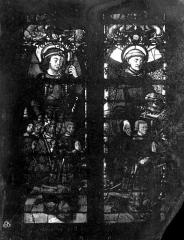 Eglise Saint-Martin - Vitrail, baie 7 (partie inférieure) : Guillaume de Montmorency, fondateur de l'église, accompagné de ses fils (Jean, Anne, François et Philippe) et de leurs saints patrons