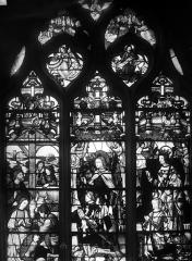 Eglise Saint-Martin - Vitrail, baie 11 (ensemble) : Nativité. Gaspard de Coligny et son saint patron. Louise de Montmorency, fille de Guillaume et d'Anne Pot, épouse de Gaspard de Coligny, et son patron saint Louis