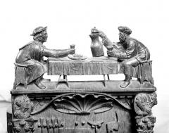 Eglise - Stalles, détail des crêtes : Les buveurs